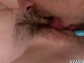 Hairy pussy spread wide while her clit is rub