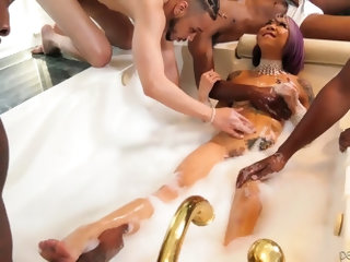 Petite Asian bitch Kimberly Chi is fucked and jizzed by several black studs