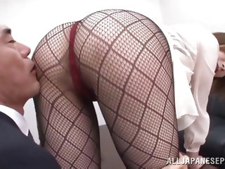 Tamaki Nakaoka knows the principal has the hots for her. She lets him have a close up view of her fishnet stockings and he rubs her legs. She rubs her