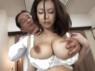 Busty Nippon milf Riai is going to please an older man that has a lot to teach her. She is getting those huge boobs groped by him and begins to be hor