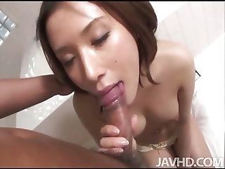 Sweet Emi Orihara in the bathroom on her knees sucking cock