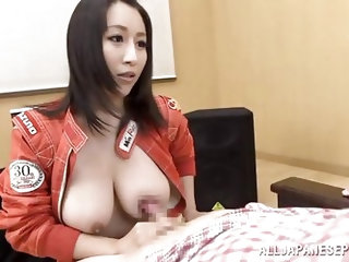 This sexy brunette race queen opens up her jacket, to reveal her sweet natural Japanese boobs. She lets her man cradle his head in her tits, and rubs