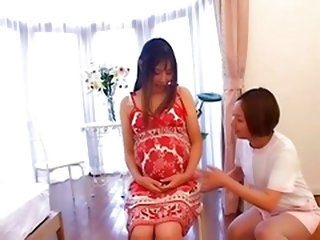 Japanese nurse takes care of her Pregnant patient