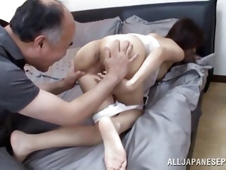This sexy Japanese mommy is reading a letter when her perverted old husband comes in the room looking to fuck her. Her rubs her shoulder and rips open