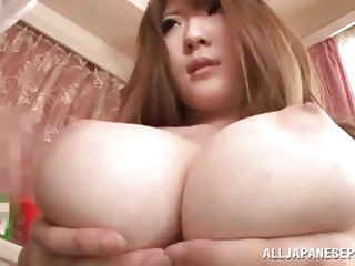 This sexy Japanese lady takes out her huge tits and lets her man stick his cock in between them. She bounces her breasts up and down on his tiff cock.