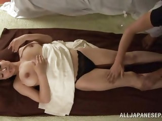 Its a pleasure to watch such a naked babe taking a massage. Mayuka is a long hair brunette babe and you can see her nice big boobs with hard nipples w