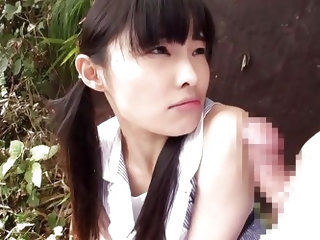 This cute Japanese slut is out in the garden and she gets down on her knees to suck his cock. She is very reluctant at first, but he eases her in by r