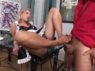 Hardcore foot fetish with beautiful blonde babe Daria Glower. She looks fantastic dressed up in a maids costume as she sits on a table and strokes thi