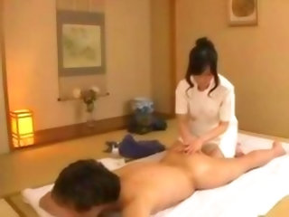 Masseuse Massaging Guy Giving Ha...