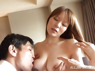 The Japanese milf has one man lick her nipples while another man watches her and films it. She gets her ass kissed then she sucks the cameraman's