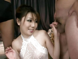 This brunette Asian has two cocks in her mouth at the same time and the dicks are so close they're almost touching. She sucks the hairy cocks goo