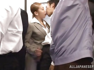 This girl is riding on a crowded train in Japan when she gets rubbed on by a handsome stud. She seductively makes out with him using lots of tongue. S