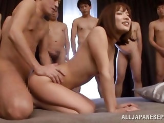 This Japanese slut is ready for a gangbang. She invites a bunch of guys over to fuck her. She gets her tight asshole fingered and then she takes cock
