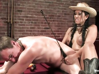 Take a look at this amazing Vietnamese milf. She has a black strapon and she's dressed like a sexy cowgirl. She flips her man over and makes him