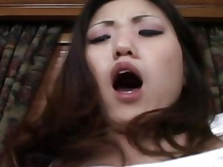 Asian babe masturbates on the couch alone but not for long! The guy approaches her and fills her pussy with his dick. She rides him on the couch in re
