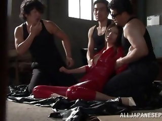 The Yakuza have a girl in a red latex costume, trapped in one of their hideouts to use her as a sex slave. Another sexy girl delivers a package and di