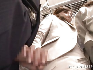 Stupid japanese cunt is in a public place and all of a sudden she feels a hard cock on her ass. She gets all horny and starts playing with it and make