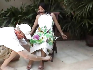 A horny angry guy has been waiting, that a long-haired Asian slut will come out from the building. The helpless lady has to obey and sit on a chair, w
