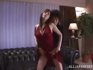 This Japanese milf has whored herself out to a rich Japanese salaryman. He sticks his hand down into her pink panties as he kisses her neck. She gets