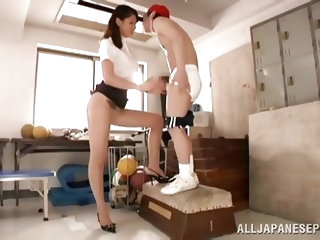 This tall and sexy Japanese coach kisses one of her students in her office. She bends over to suck on his penis and gets him really hard. She won&