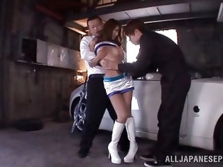 Ria Horisaki is a beautiful race queen and she is pushed up against the car by two strong men. They lift up her skirt and grab her pussy. One of the m