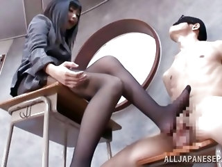 Brunette teacher likes treating her bad students with her feet. She got this one tied on a chair, blindfolded him and rubbed his cock with her feet. T